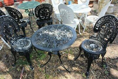 A Vintage Black 3 Piece Victorian Style Cast Metal Outdoor Setting
