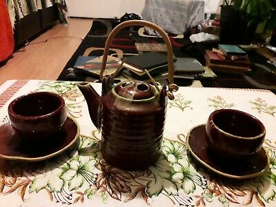collectable rustic slip ware pottery  tea pot 2 cups and 2 saucers handmade