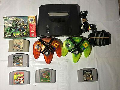 Nintendo 64 Launch Edition Charcoal Grey Console (NTSC) with Mario games.