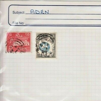 A couple of Aden stamps hinged to a sheet with a protective covering