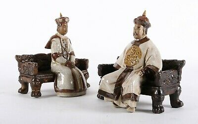 Two Chinese mandarin figurines of glazed porcelain