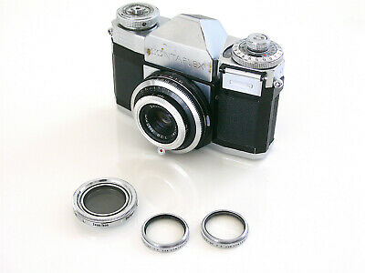 zeiss ikon contaflex with 3 lenses and accessories