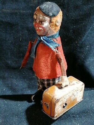 Schuco Tanzfigur, 1930 clown with Suitcase with working spring charge