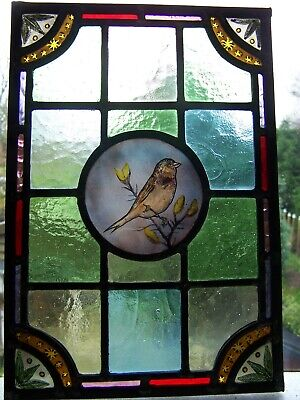 Victorian style stained glass panel with bird.