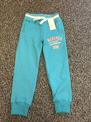 Brand New Girls 'Mckenzie' Turquoise Joggers. Age 6- 7 Years. Label Attached