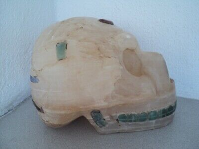 Calcite Alabastre Skull with inlays of precious stones and a being engraving