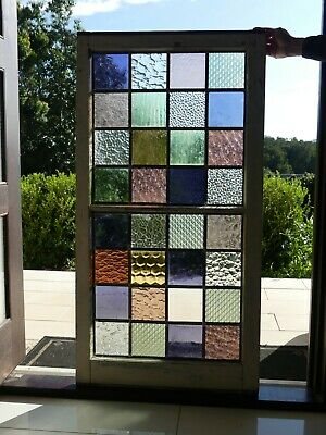Leadlight stained glass window in vintage timber frame