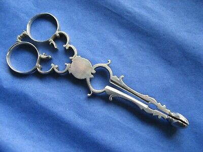 A Pair Of Solid Silver Antique Sugar Nips.