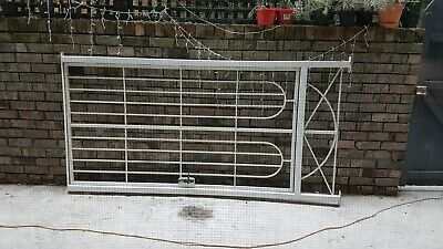 2 Wrought Iron white lockable gates with keys ....new locks....Pick up only