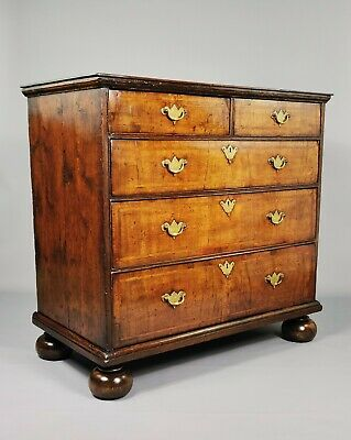 An Early 18th Century Walnut Chest Of Drawers.