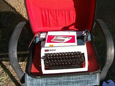 As new Optima portable typewriter in perfect condition & carry case.