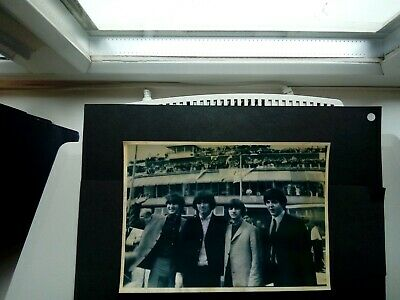 Original Photograph of the Beatles in mid 60's taken on arrival at an Airport