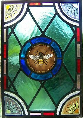 Victorian style stained glass panel with bee