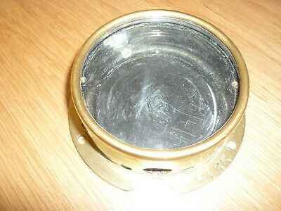 Ships Brass pressure gauge . case and glass only.  4 inches  wide across  front