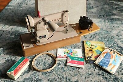 vintage singer sewing machine with accessories in box and instruction manual
