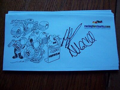 A RACINGFORCHARITY ENVELOPE SIGNED BY ALAN McNISH AND RALPH FIRMAN