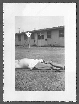 Headless Out-Of-Frame Man On Lawn. Abstract Vintage Snapshot.