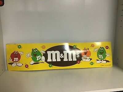 M&Ms cardboard banner with 90s M&M red an green orange characters