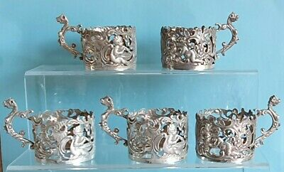 Antique silver coffee cup holders x 5. William Comyns. Birmingham.1900.