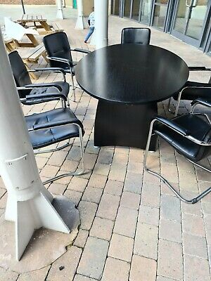 Black meeting table and chairs