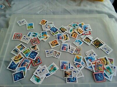 100 2nd class Christmas themed unfranked stamps on paper  lot 8