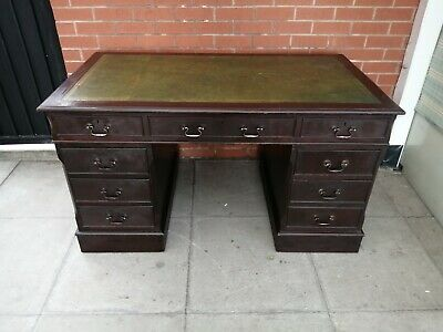 A Large Twin Pedestal Green Leather Inlay Desk