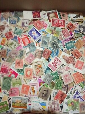 100+ worldwide unchecked off paper stamps mostly different
