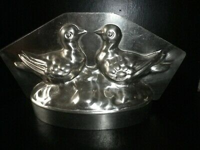 Professional, vintage metal chocolate mold, two doves on base.