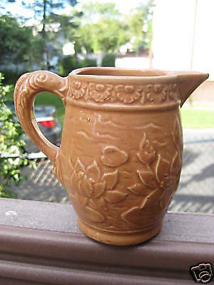 Early McCoy art pottery pitcher fish handle waterlilly