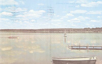 What's a vacation without a boat & peaceful, skyblue lake Chrome Postcard
