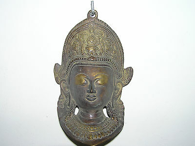 Antique Bronze Wall Decoration With The Face Of An Asian Woman.