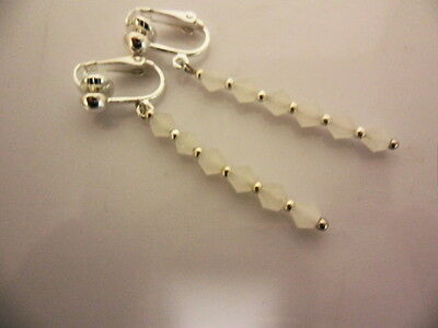 A PAIR OF WHITE CRYSTAL GLASS BEAD  SILVER  PLATED CLIP ON DROP EARRINGS. NEW.