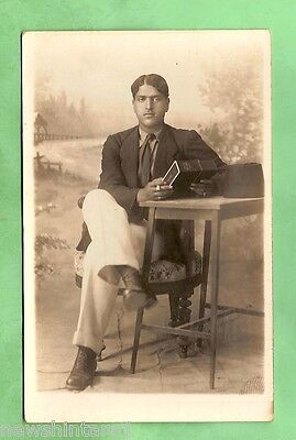 #a. Postcard -   Man Sitting With Cigarette & Book