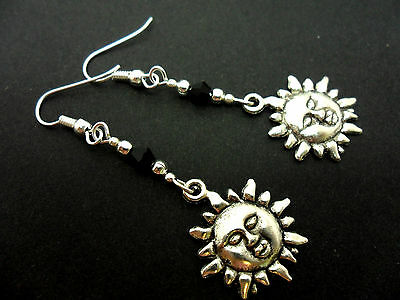 A PAIR OF  TIBETAN SILVER DANGLY   SUN  BLACK CRYSTAL BEAD EARRINGS. NEW.