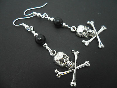 A PAIR OF  TIBETAN SILVER DANGLY BLACK BEAD SKULL AND CROSSBONES  EARRINGS. NEW.