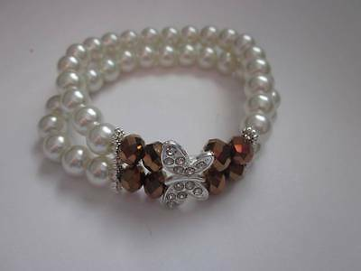 Two Line Cream Glass Pearl Bronze Glass Bead Silver Butterfly Stretch Bracelet