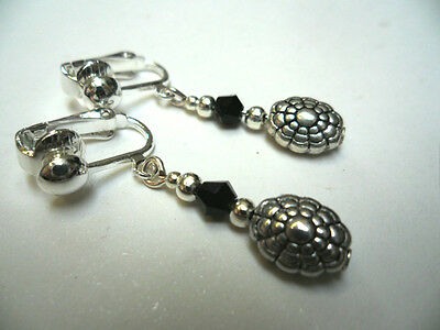 A PAIR TIBETAN SILVER  & BLACK CRYSTAL BEAD  DANGLY CLIP ON EARRINGS.