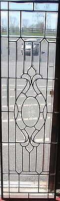 Large early 20th century beveled stained glass window