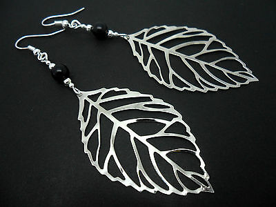 A PAIR OF  BIG  DANGLY SILVER COLOUR  LEAF & BLACK BEAD  EARRINGS. NEW.