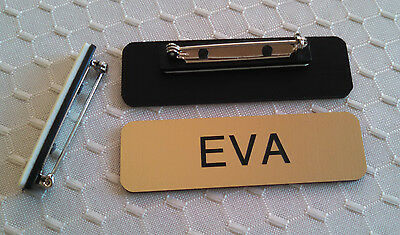 "Name Badges 2.5""x0.75"" Gold -Black letters Corners Rounded w/ pin attachment"