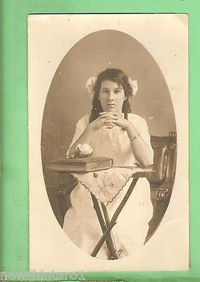 #d. Postcard - Young Woman With Book & Flower