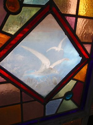 Eastlake stained glass window featuring painted and fired sea gulls