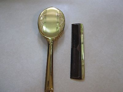 vintage gold tone art deco brush and comb very nice looks unused