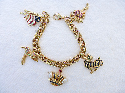 Trifari charm bracelet with five charms in gold tone enamel and rhinestones R39