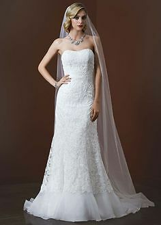 Brand new wedding dress, with tags. Size 8 with under slip. Never altered!