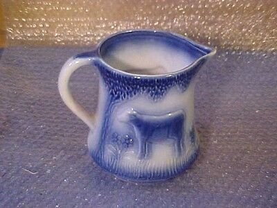VINTAGE FLOW BLUE WATER MILK PITCHER POTTERY COW IN MEADOW STONEWARE