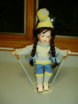 Girl Skier Doll, Porcelain head, hands and legs. Cloth body.
