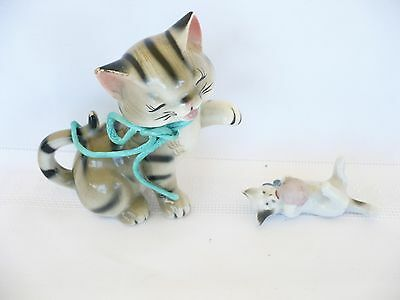 Two small cats. Japan. Vintage. Happy stripped grey cat and small cat with ball