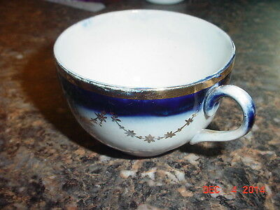 RARE VINTAGE H.R. WYLLIE GOLD SNOWFLAKE/STAR FLOW BLUE COFFEE/TEA CUP