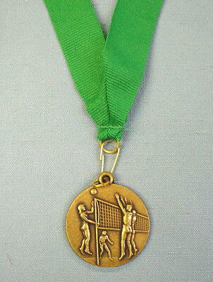 """gold female action Volleyball medal green drape 1 1/2"""" diameter"""